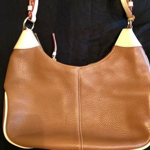 Tan and cream Dooney & Bourke leather purse